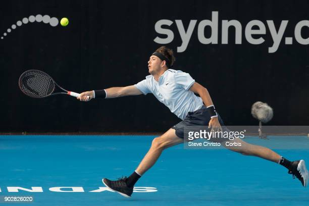 Jared Donaldson of the United States plays a forehand in his first round match against Gilles Simon of France during day three of the 2018 Sydney...