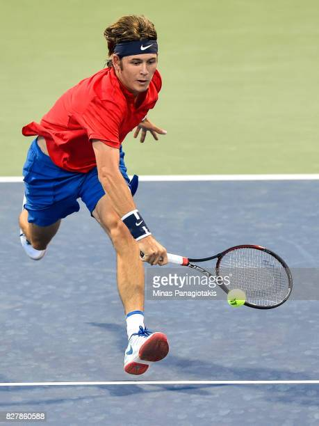 Jared Donaldson of the United States prepares to hit a return shot against Benoit Paire of France during day five of the Rogers Cup presented by...
