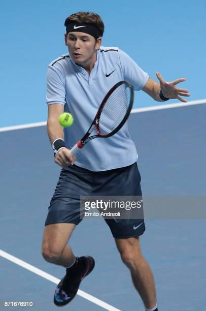 Jared Donaldson of the United States returns a backhand in his match against Karen Khachanov of Russia during Day 2 of the Next Gen ATP Finals on...