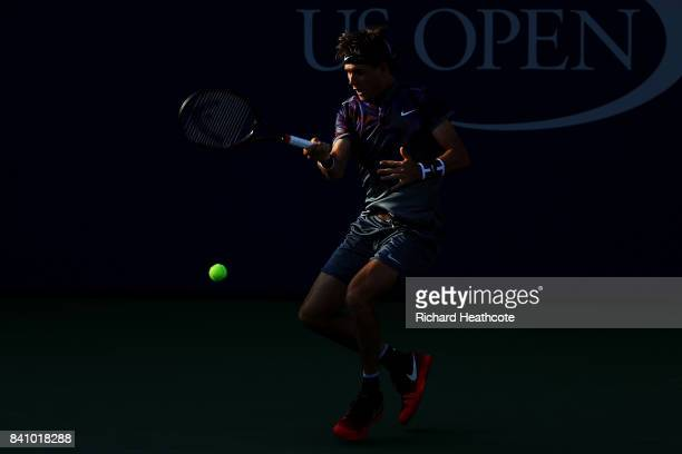 Jared Donaldson of the United States returns a shot against Lucas Pouille of France during their second round Men's Singles match on Day Three of the...