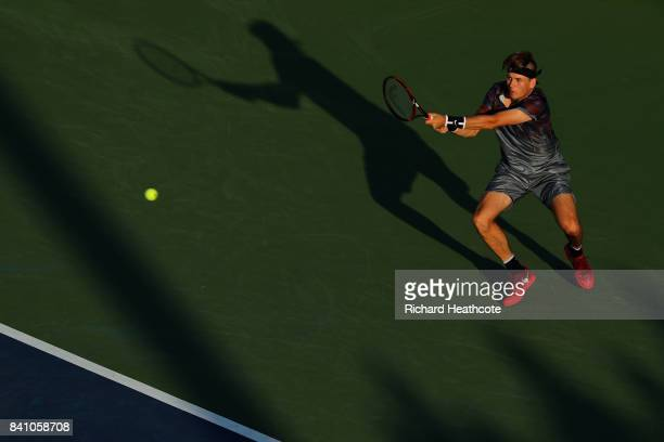 Jared Donaldson of the United States returns a shot against Lucas Pouille of France during their first round Men's Singles match on Day Three of the...