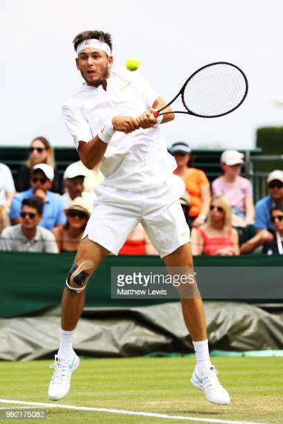 Jared Donaldson of the United States returns a shot against Stefanos Tsitsipas of Greece during their Men's Doubles first round match on day four of...