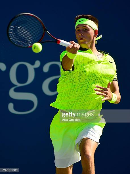 Jared Donaldson of the United States returns a shot to David Goffin of Belgium during his first round Men's Singles match on Day Two of the 2016 US...