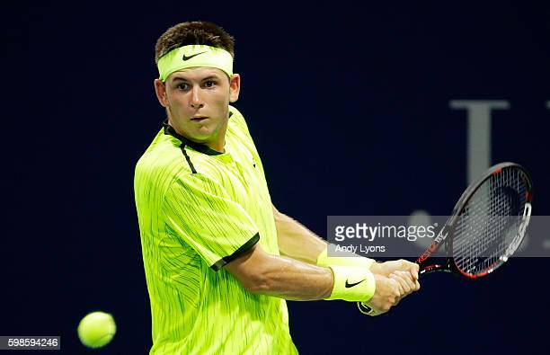 Jared Donaldson of the United States returns a shot to Viktor Troicki of Serbia during his second round Men's Singles match on Day Four of the 2016...