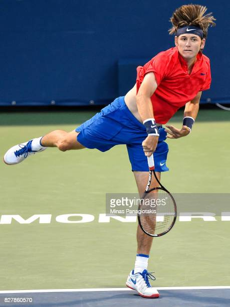 Jared Donaldson of the United States serves against Benoit Paire of France during day five of the Rogers Cup presented by National Bank at Uniprix...