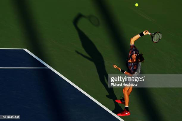 Jared Donaldson of the United States serves against Lucas Pouille of France during their second round Men's Singles match on Day Three of the 2017 US...
