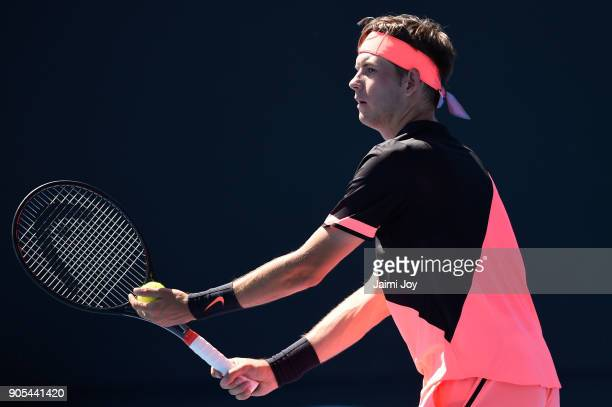 Jared Donaldson of the United States serves in his first round match against Albert RamosVinolas of Spain on day two of the 2018 Australian Open at...