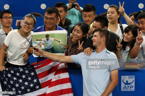 Jared Donaldson of the United States takes selfie with supporters after the match against Kyle Edmund of Great Britain during Day 3 of 2017 ATP...