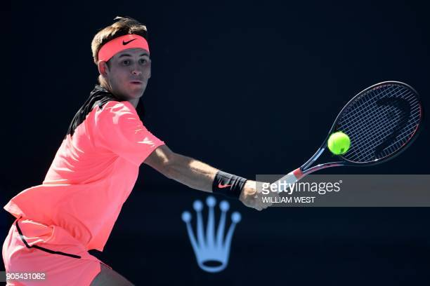 Jared Donaldson of the US hits a return against Spain's Albert RamosVinolas during their men's singles first round match on day two of the Australian...