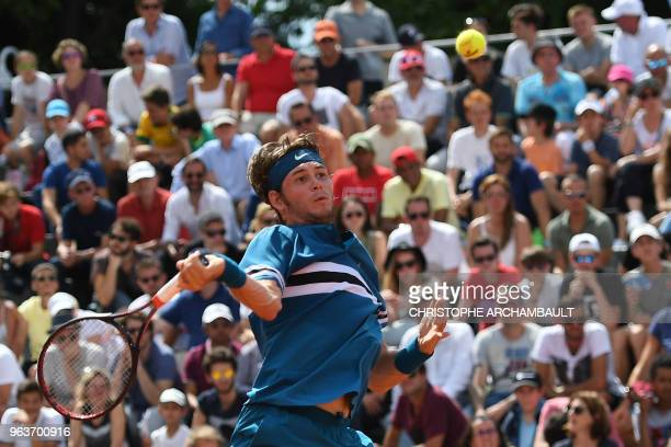 Jared Donaldson of the US returns the ball to Bulgaria's Grigor Dimitrov during their men's singles second round match on day four of The Roland...