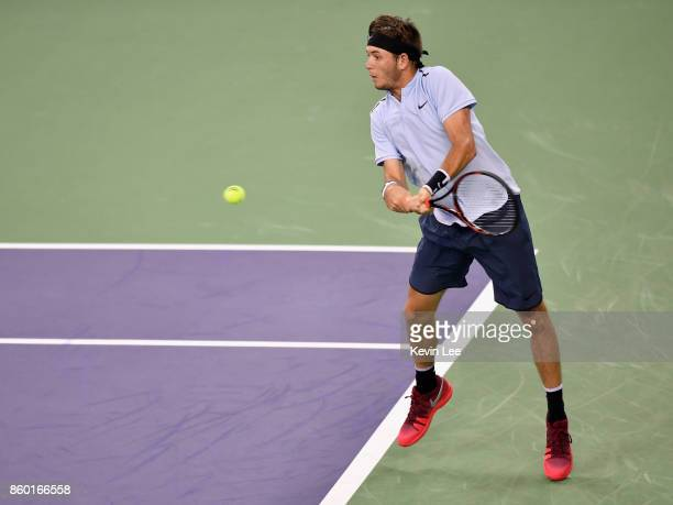 Jared Donaldson of United States returns a shot to Rafael Nadal of Spain in their Men's Single match during Round 2 of 2017 ATP Shanghai Rolex...