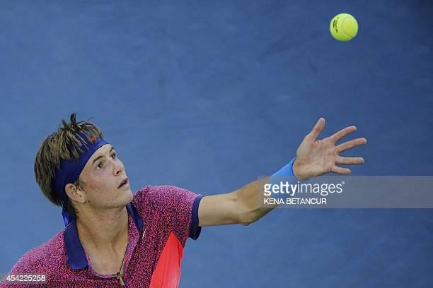 Jared Donaldson of United States tosses the ball Gael Monfils of France during their 2014 US Open men's singles match at the USTA Billie Jean King...