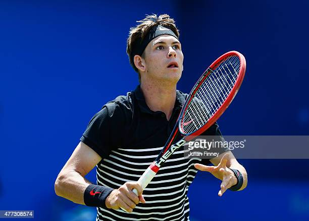 Jared Donaldson of USA looks to smash in his men's singles first round match against John Isner of USA during day two of the Aegon Championships at...
