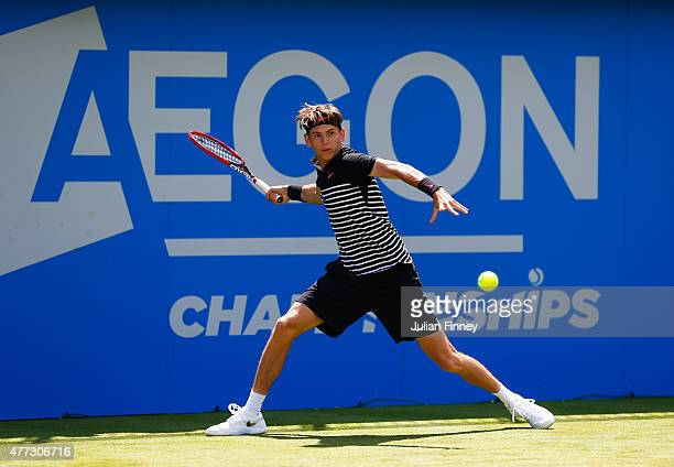 Jared Donaldson of USA plays a forehand in his men's singles first round match against John Isner of USA during day two of the Aegon Championships at...