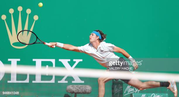 US Jared Donaldson reaches out to the ball during his round of 64 tennis match against Spain's Albert RamosVinolas at the MonteCarlo ATP Masters...