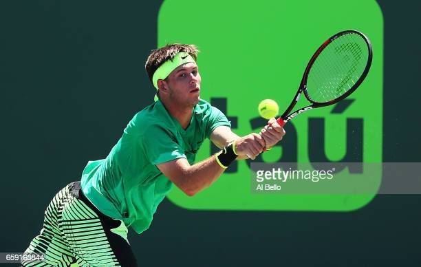 Jared Donaldson returns a shot against Jack Sock during Day 9 of the Miami Open at Crandon Park Tennis Center on March 28 2017 in Key Biscayne Florida