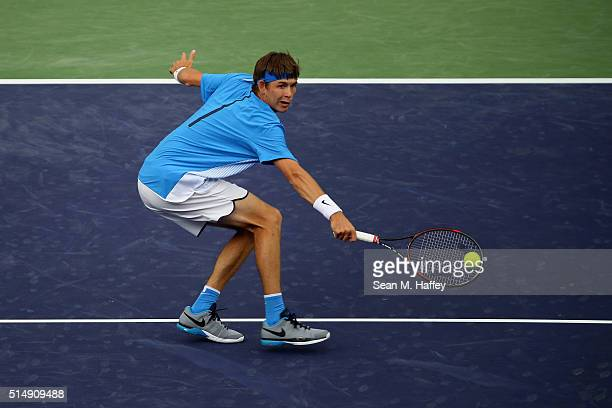 Jared Donaldson returns a shot against Vasek Pospisil of Canada during the BNP Paribas Open at the Indian Wells Tennis Garden on March 11 at Indian...