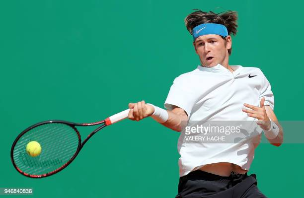 Jared Donaldson returns the ball to Spain's Albert Ramos-Vinolas during their round of 64 tennis match at the Monte-Carlo ATP Masters Series...
