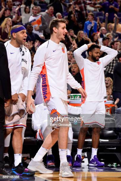 Jared Dudley and Dragan Bender of the Phoenix Suns during the game against the San Antonio Spurs on December 9 2017 at Talking Stick Resort Arena in...