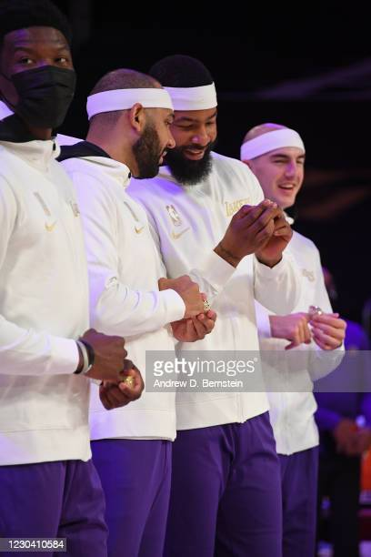 Jared Dudley and Markieff Morris of the Los Angeles Lakers react as they get their 2019-20 NBA Championship ring during the ring ceremony before the...
