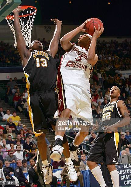 Jared Dudley of the Boston College Eagles is fouled by Joah Tucker of the WisconsinMilwaukee Panthers during the second round of the 2005 NCAA...