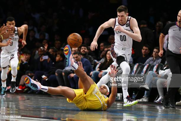 Jared Dudley of the Los Angeles Lakers falls to the court battling for the ball against Rodions Kurucs of the Brooklyn Nets at Barclays Center on...