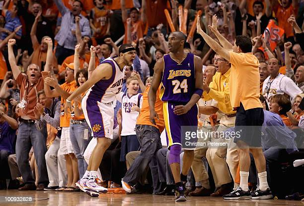 Jared Dudley of the Phoenix Suns celebrates in front of Kobe Bryant of the Los Angeles Lakers after Dudley hit a 3 point shot during Game Four of the...