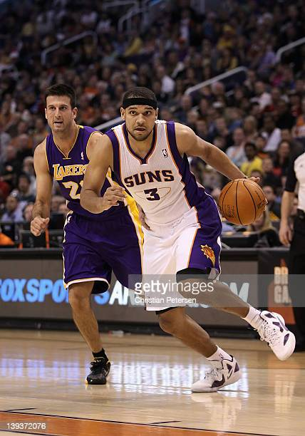 Jared Dudley of the Phoenix Suns drives the ball past Jason Kapono of the Los Angeles Lakers during the NBA game at US Airways Center on February 19...