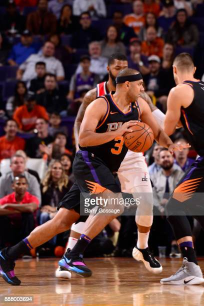 Jared Dudley of the Phoenix Suns handles the ball against the Washington Wizards on December 7 2017 at Talking Stick Resort Arena in Phoenix Arizona...