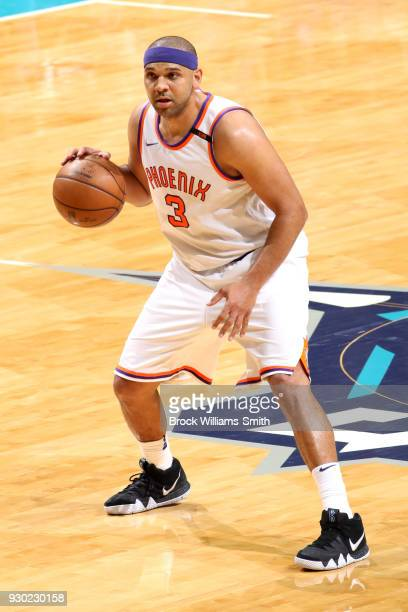 Jared Dudley of the Phoenix Suns handles the ball against the Charlotte Hornets on March 10 2018 at Spectrum Center in Charlotte North Carolina NOTE...