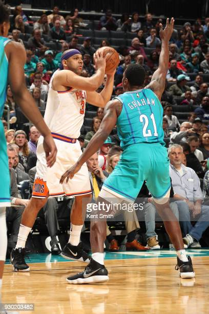 Jared Dudley of the Phoenix Suns passes the ball during the game against the Charlotte Hornets on March 10 2018 at Spectrum Center in Charlotte North...