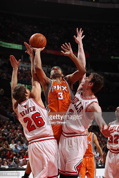 Jared Dudley of the Phoenix Suns shoots against Kyle Korver and Omer Asik of the Chicago Bulls on April 5 2011 at the United Center in Chicago...