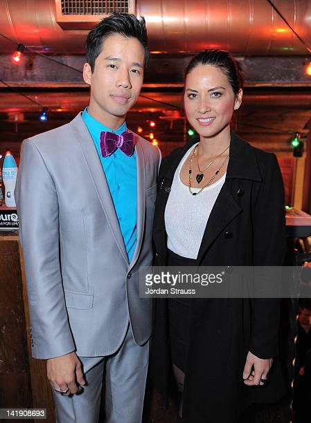 Jared Eng and Olivia Munn attend Just Jared's 30th at Pink Taco on March 23 2012 in Los Angeles California