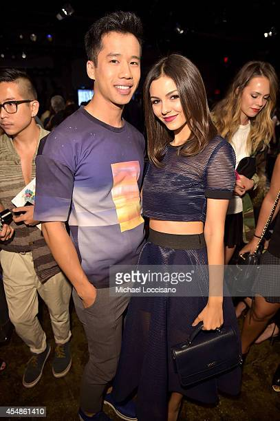 Jared Eng of Just Jared and singersongwriter Victoria Justice attend the DKNY Women's fashion show during MercedesBenz Fashion Week Spring 2015 on...