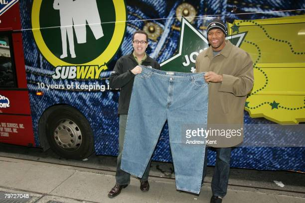 Jared Fogle, a Subway spokesperson, and New York Giants Defensive End Michael Strahan pose with Fogle's old pants while celebrating 10 years of...
