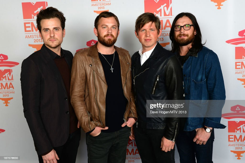 Jared Followill, Caleb Followill, Matthew Followill and Nathan Followill of Kings of Leon pose in the Exclusive Arrivals Studio during MTV EMA's 2013 at the Ziggo Dome on November 10, 2013 in Amsterdam, Netherlands.
