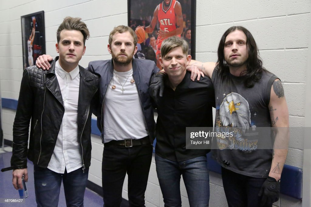 Jared Followill, Caleb Followill, Matthew Followill, and Nathan Followill of Kings of Leon pose prior to the opening of the 'Mechanical Bull' tour at Philips Arena on February 5, 2014 in Atlanta, Georgia.