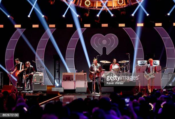 Jared Followill Caleb Followill Nathan Followill and Matthew Followill of Kings of Leon perform onstage during the 2017 iHeartRadio Music Festival at...