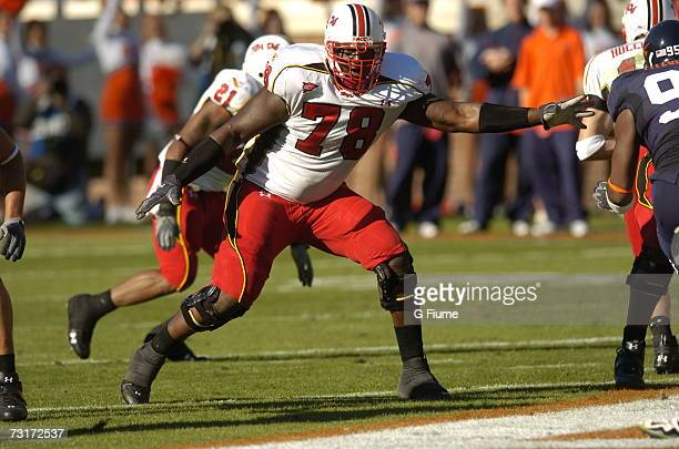 Jared Gaither of the Maryland Terrapins pass blocks against the Virginia Cavaliers October 14 2006 at the Carl Smith Center in Charlottesville...