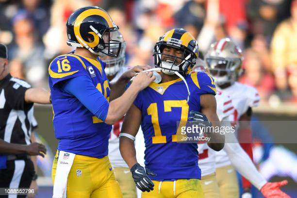 Jared Goff adjusts the pads of Robert Woods of the Los Angeles Rams after a hard hit against the San Francisco 49ers at Los Angeles Memorial Coliseum...