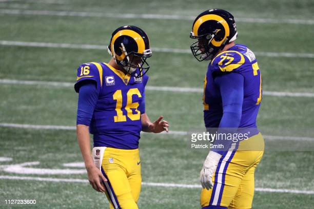 Jared Goff and Andrew Whitworth of the Los Angeles Rams speak in the second half against New England Patriots during Super Bowl LIII at Mercedes-Benz...