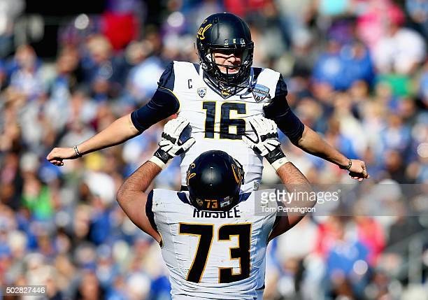 Jared Goff of the California Golden Bears celebrates with Jordan Rigsbee of the California Golden Bears after throwing a touchdown pass against the...