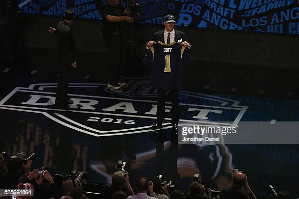 Jared Goff of the California Golden Bears holds up a jersey after being picked overall by the Los Angeles Rams during the first round of the 2016 NFL...