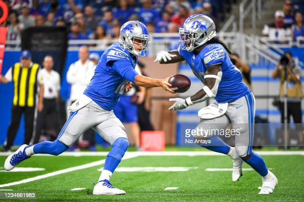 Jared Goff of the Detroit Lions hands the ball off to Jamaal Williams of the Detroit Lions during the first quarter of a preseason game at Ford Field...