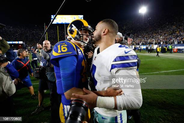 Jared Goff of the Los Angeles Rams and Dak Prescott of the Dallas Cowboys speak after the NFC Divisional Playoff game at Los Angeles Memorial...