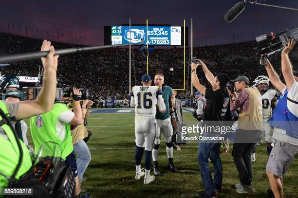 Jared Goff of the Los Angeles Rams and Nick Foles of the Philadelphia Eagles shake hands after their game at the Los Angeles Memorial Coliseum on...