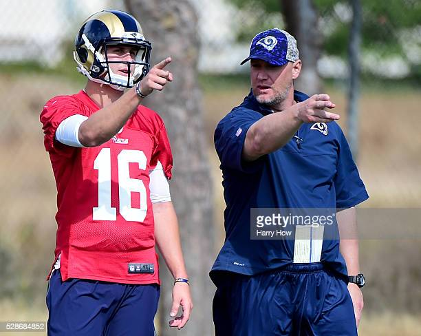 Jared Goff of the Los Angeles Rams and quarterback coach Chris Weinke discuss a play during a Los Angeles Rams rookie camp on May 06 2016 in Oxnard...