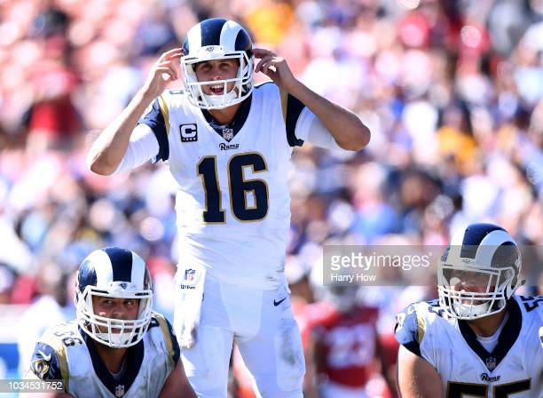 Jared Goff of the Los Angeles Rams calls a play at the line behind Austin Blythe and Brian Allen during the fourth quarter in a 340 win over the...