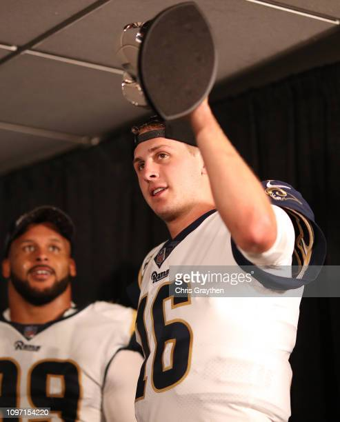 Jared Goff of the Los Angeles Rams celebrates with the NFC Trophy after defeating the New Orleans Saints in the NFC Championship game at the...