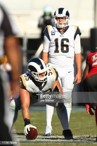 Jared Goff of the Los Angeles Rams checks out the defense as Brian Allen prepares to hike the ball during the game against the Tampa Bay Buccaneers...